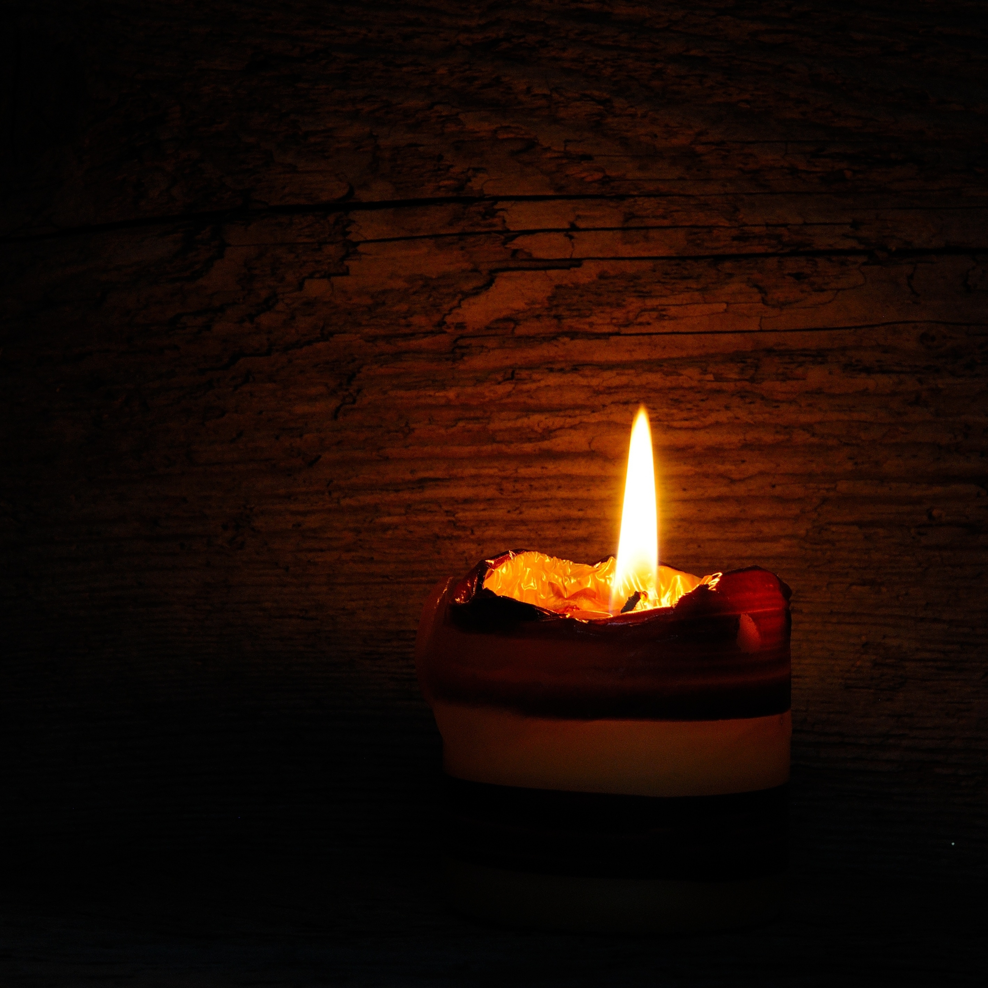Lit Candle Light Flame in the Dark iPad Wallpaper